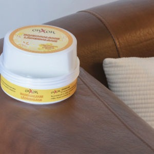 OnXOn Leather Balm on a chair
